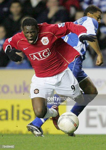 Louis Saha of Manchester United clashes with Ulises de la Cruz of Reading during the FA Cup sponsored by EON Fifth Round Replay match between Reading...