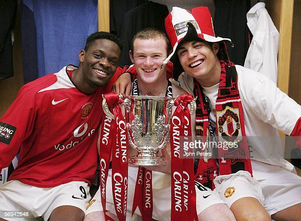 Louis Saha Wayne Rooney and Cristiano Ronaldo of Manchester United pose with the Carling Cup trophy in the dressing room after the Carling Cup Final...