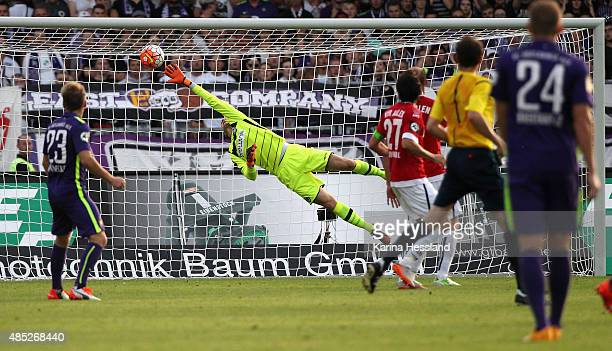 Louis Samson of Aue scores the opening goal past goalkeeper Daniel Bernhardt of Aalen during the Third League match between FC Erzgebirge Aue and VFR...
