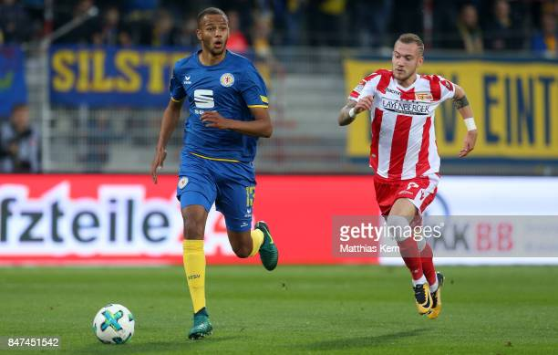 Louis Samson of Braunschweig battles for the ball with Marcel Hartel of Berlin during the Second Bundesliga match between 1 FC Union Berlin and...