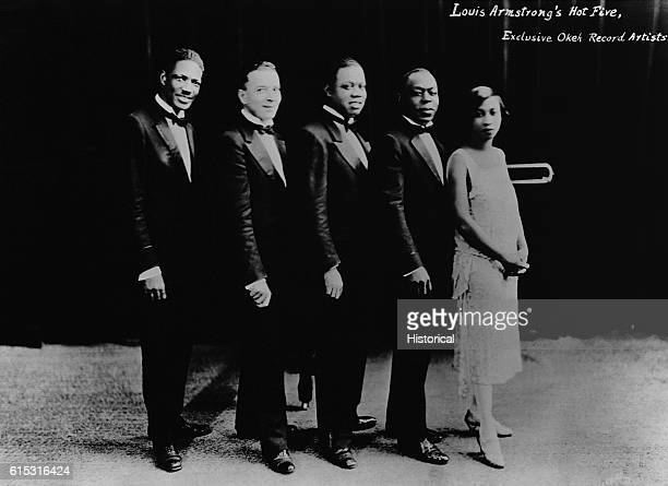 Louis 'Satchmo' Armstrong and his 'Hot Five' band left to right Johnny St Cyr Edward 'Kid' Ory Louis Armstrong Johnny Dodds Lillian Armstrong