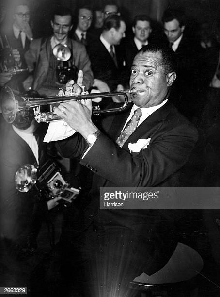 Louis 'Satchmo' Armstrong , the great jazz trumpeter and vocalist playing at the Savoy Hotel, London.