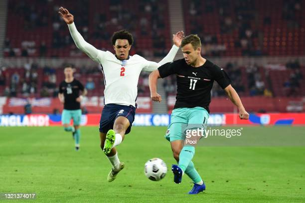 Louis Schaub of Austria makes a cross whilst under pressure from Trent Alexander-Arnold of England during the international friendly match between...