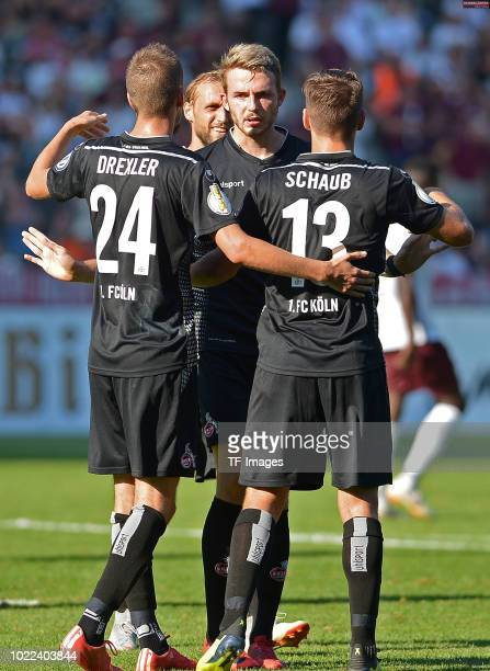 Louis Schaub of FC Koeln celebrates after scoring his team`s ninth goal with team mates during the DFB Cup first round match between BFC Dynamo and 1...