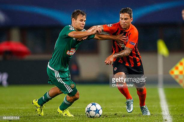 Louis Schaub of Vienna competes for the ball with Marlos of Donetsk during the UEFA Champions League Qualifying Round Play Off First Leg match...