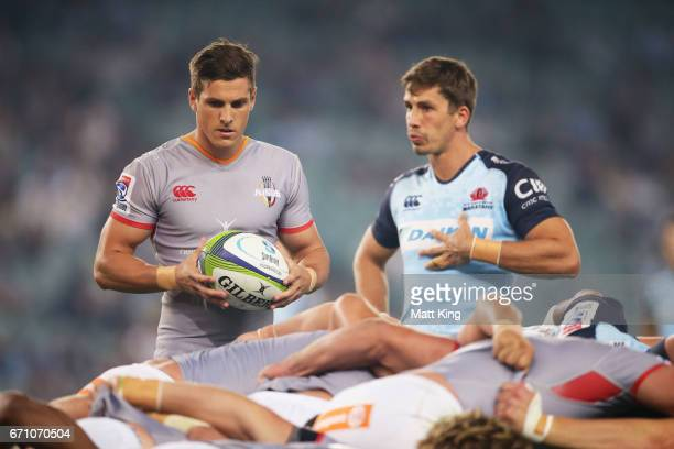 Louis Schreuder of the Kings waits to put the ball in the scrum as Jake Gordon of the Waratahs looks on during the round nine Super Rugby match...