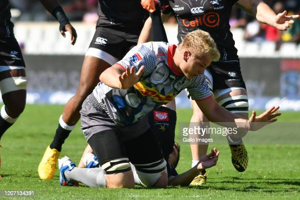 Louis Schreuder of the Sharks tackled by Johan du Toit of the Stormers uring the Super Rugby match between Cell C Sharks and DHL Stormers at Jonsson...