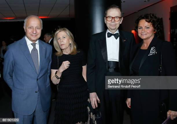 Louis Schweitzer and his wife Agnes Schmitz standing between Laurent Fabius and his wife Francoise Castro attend the AROP Charity Gala with the...