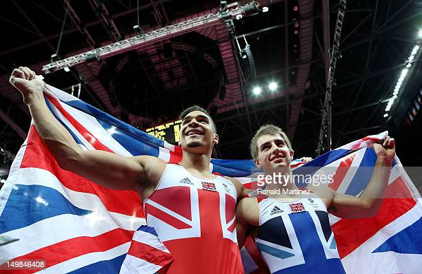 Louis Smith and Max Whitlock of Great Britain celebrate with a Union Flag during the Artistic Gymnastics Men's Pommel Horse Final on Day 9 of the...