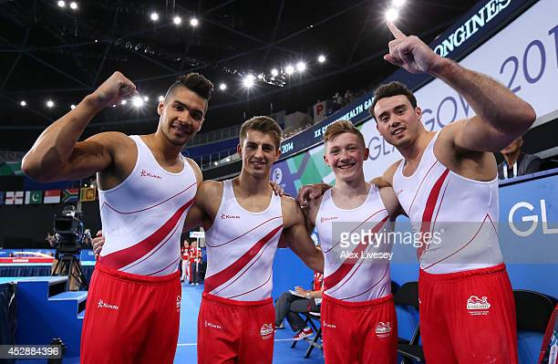 Louis Smith, Max Whitlock, Nile Wilson and Kristian Thomas of England celebrate winning the gold medal in the Gymnastics Artistic Team Final at SECC...