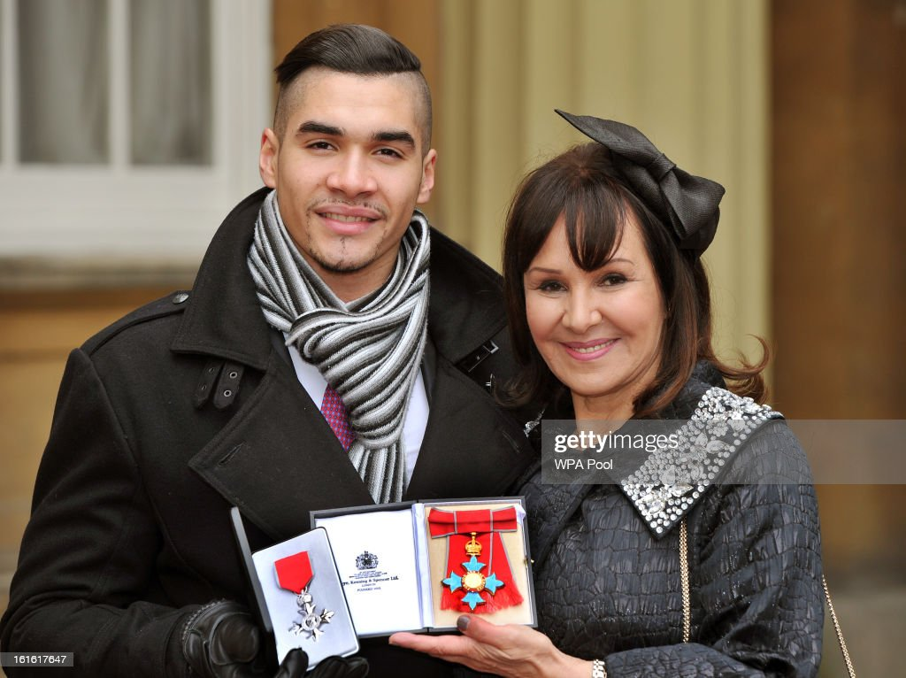 Louis Smith MBE and Arlene Phillips CBE hold their medals after they were presented to them by Queen Elizabeth II at the Investiture Ceremony at Buckingham Palace on February 13, 2012 in London, England.