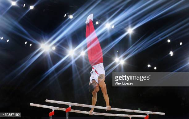 Louis Smith of England competes in the Parallel Bars on the way to winning gold medal in the Gymnastics Artistic Team Final at SECC Precinct during...