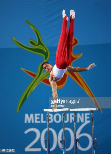 Louis Smith of England competes on the parallel bars during the Men's Team competition in the artistic gymnastics at the Rod Laver Arena during day...