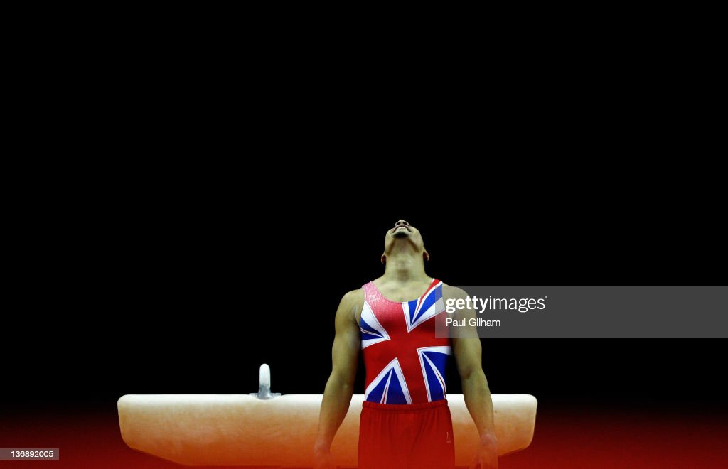 Louis Smith of Great Britain celebrates by the Pommel Horse on his way to a gold medal during the Men's Artistic Gymnastics Individual Olympic Qualification Final round at North Greenwich Arena on January 12, 2012 in London, England.