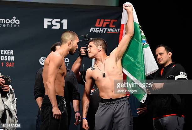 Louis Smolka and Brandon Moreno of Mexico faceoff during the UFC Fight Night weighin at the Oregon Convention Center on September 30 2016 in Portland...