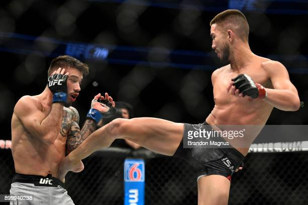 Louis Smolka kicks Matheus Nicolau of Brazil in their flyweight bout during the UFC 219 event inside TMobile Arena on December 30 2017 in Las Vegas...