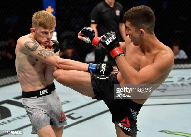 Louis Smolka kicks Ryan MacDonald in their bantamweight bout during the UFC Fight Night event at Rogers Arena on September 14, 2019 in Vancouver,...