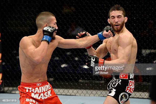 Louis Smolka punches Alpetkin Ozkilic in their featherweight fight during the UFC Fight Night event inside The Arena at Gwinnett Center on January 15...