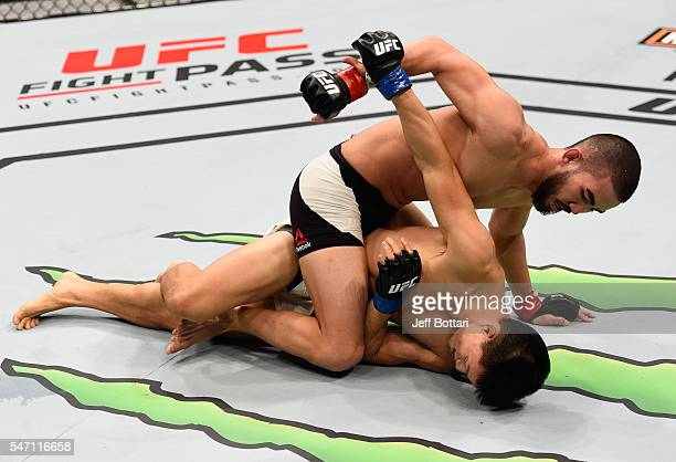 Louis Smolka punches Ben Nguyen in their flyweight bout during the UFC Fight Night event on July 13, 2016 at Denny Sanford Premier Center in Sioux...