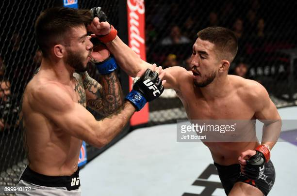 Louis Smolka punches Matheus Nicolau of Brazil in their flyweight bout during the UFC 219 event inside TMobile Arena on December 30 2017 in Las Vegas...