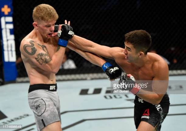 Louis Smolka punches Ryan MacDonald in their bantamweight bout during the UFC Fight Night event at Rogers Arena on September 14, 2019 in Vancouver,...
