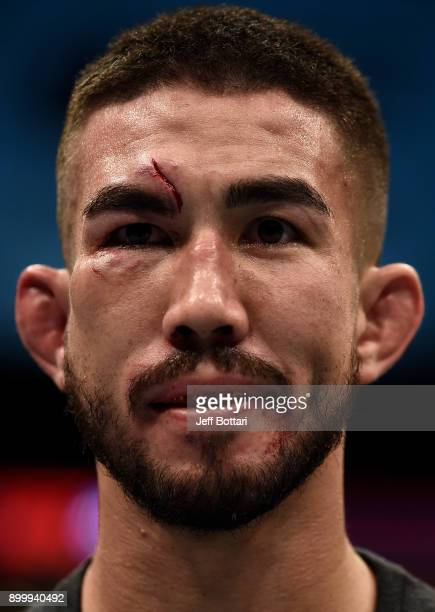 Louis Smolka reacts after his loss to Matheus Nicolau of Brazil in their flyweight bout during the UFC 219 event inside TMobile Arena on December 30...