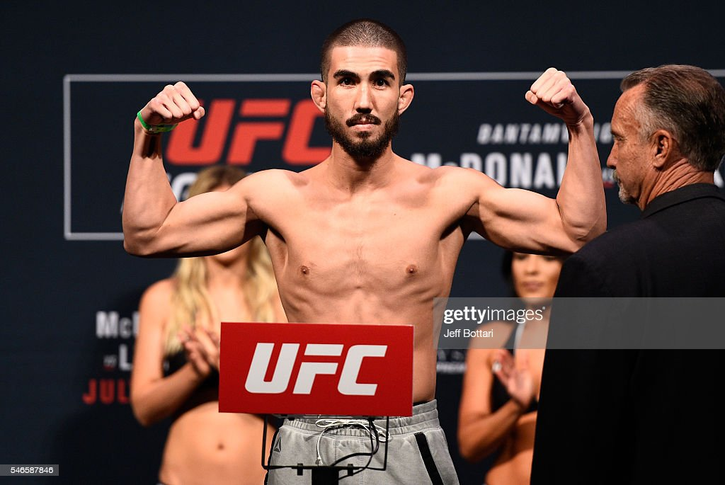 Louis Smolka steps onto the scale during the UFC Fight Night weigh-in at Denny Sanford Premier Center on July 12, 2016 in Sioux Falls, South Dakota.
