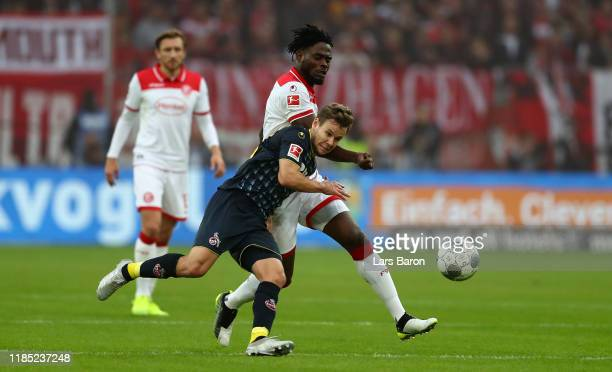 Louis Staub of Koeln is challenged by Kasim Adams of Duesseldorf during the Bundesliga match between Fortuna Duesseldorf and 1 FC Koeln at Merkur...
