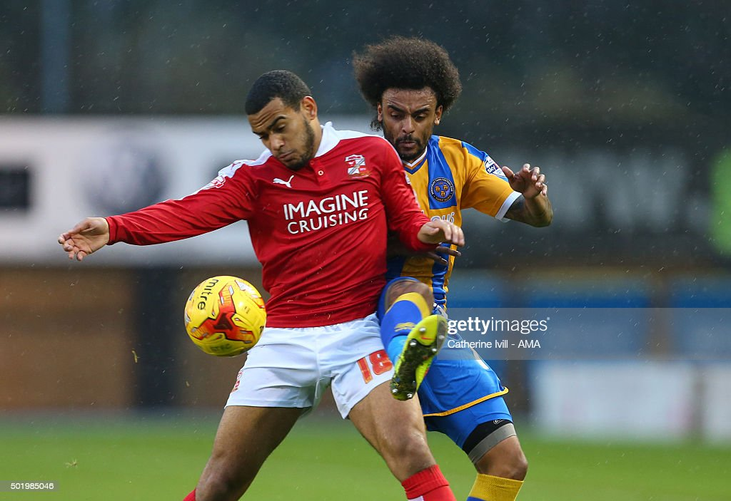 Louis Thompson of Swindon Town and Junior Brown of Shrewsbury Town during the Sky Bet League One match between Shrewsbury Town and Swindon Town at New Meadow on December 19, 2015 in Shrewsbury, United Kingdom.