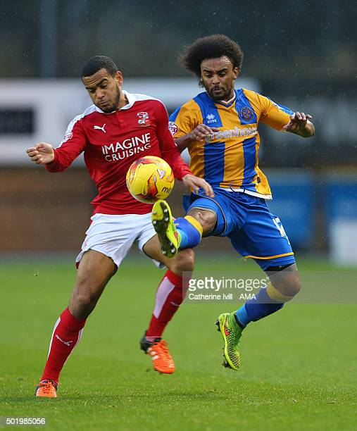 Louis Thompson of Swindon Town and Junior Brown of Shrewsbury Town during the Sky Bet League One match between Shrewsbury Town and Swindon Town at...