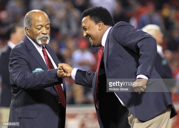 Louis Tiant and Pedro Martinez greet each other as members of the All Fenway team are introduced on the field The All Fenway Park team is honored in...