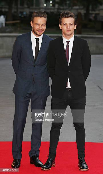 Louis Tomlinson and Liam Payne attend the Believe in Magic Cinderella Ball at the Natural History Museum on August 10 2015 in London England