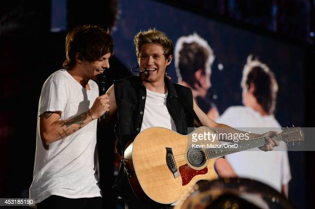 Louis Tomlinson and Niall Horan of One Direction perform onstage during the Where We Are tour at Met Life Stadium on August 4 2014 in New York City