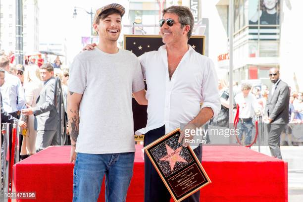 Louis Tomlinson and Simon Cowell attend a ceremony honoring Cowell with a star on the Hollywood Walk of Fame on August 22 2018 in Hollywood California