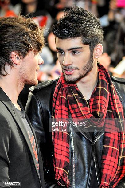 Louis Tomlinson and Zayn Malik of One Direction meet Japanese fans to promote 'The 1Derland THIS IS US' on November 3 2013 in Chiba Japan