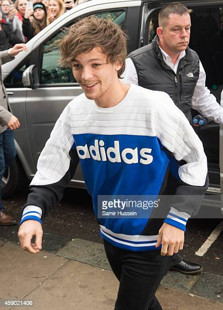 Louis Tomlinson attends to record the Band Aid 30 single on November 15 2014 in London England