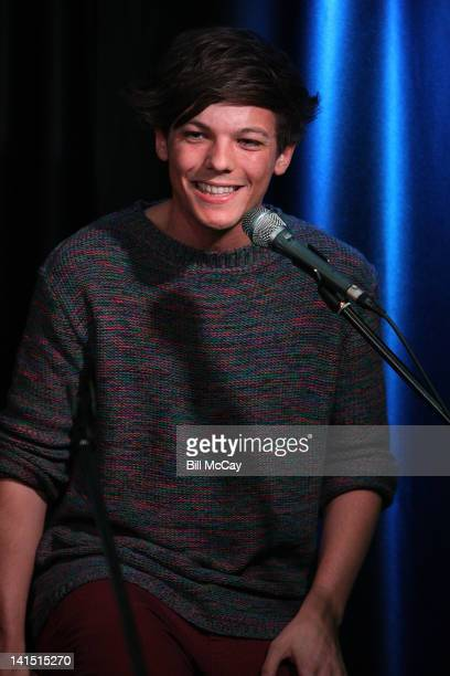 Louis Tomlinson from the band One Direction performs at Radio Station Q102 iHeartRadiod Performance Theater March 17, 2012 in Bala Cynwyd,...