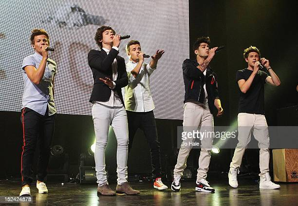 Louis Tomlinson Harry Styles Liam Payne Zayn Malik and Niall Horan of One Direction perform on stage at The Roundhouse on September 20 2012 in London...