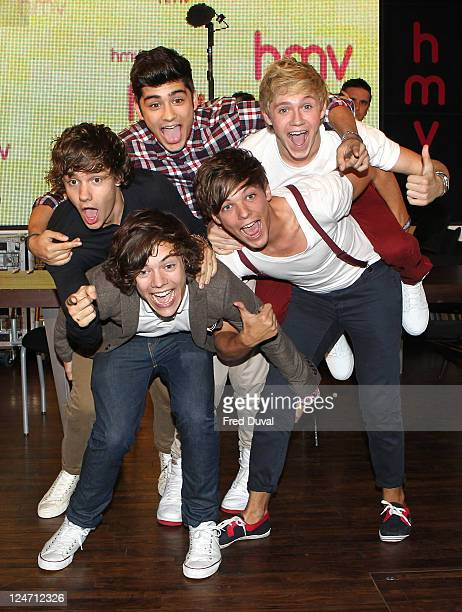 Louis Tomlinson Harry Styles Zian Malik Liam Payne Niall Horan and of One Direction attends the launch of their debut single 'What Makes You...