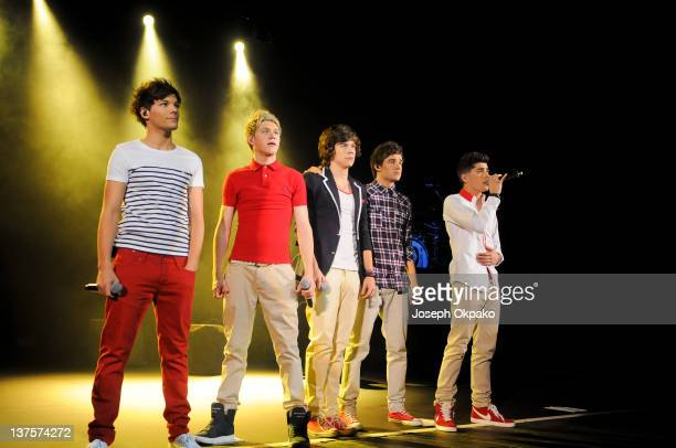 Louis Tomlinson Niall Horan Harry Styles Liam Payne and Zayn Malik of One Direction perform at HMV Hammersmith Apollo on January 22 2012 in London...