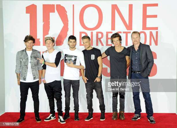 Louis Tomlinson, Niall Horan, Zayn Malik, Liam Payne and Harry Styles of One Direction pose with director Morgan Spurlock at a photocall to launch...