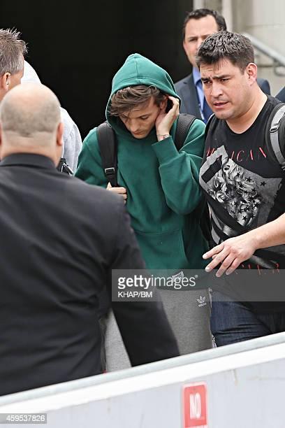 Louis Tomlinson of One Direction arrives in Sydney on November 25 2014 in Sydney Australia
