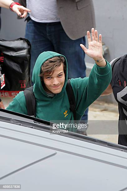 Louis Tomlinson of One Direction arrives in Sydney on November 25 2014 in Sydney Australia