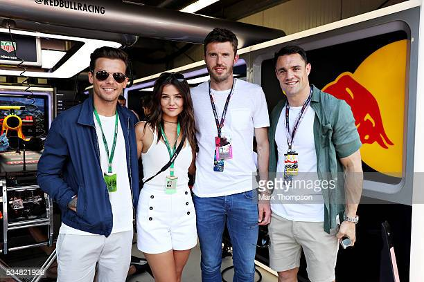 Louis Tomlinson singer his girlfriend Danielle Campbell Michael Carrick football player and Dan Carter rugby player outside the Red Bull Racing...