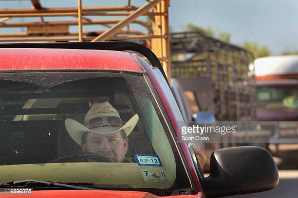 Louis Valenzuela waits in line to unload cattle at the Abilene Livestock Auction July 26 2011 in Abilene Texas A severe drought in the region has...