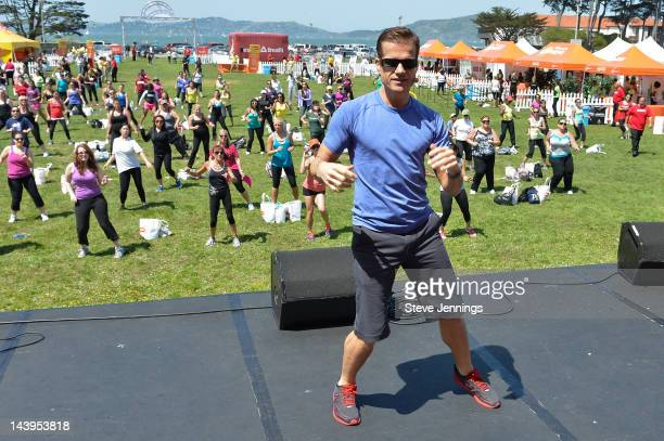Louis Van Amstel instructs the crowd at the Self Magazine 19th Annual Workout In The Park at Little Marina Green on May 5 2012 in San Francisco...