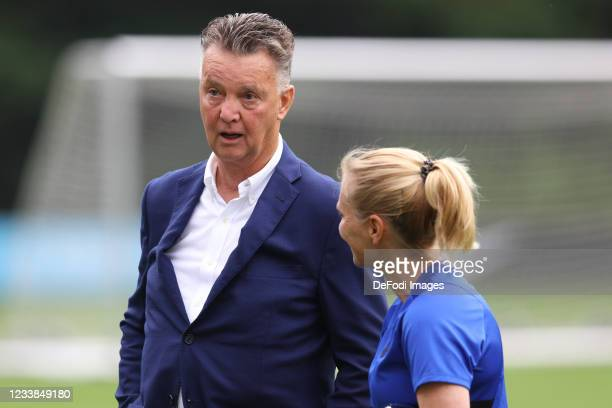 Louis van Gaal and Sarina Wiegman of Netherlands speaks with during the training session of Netherlands Women at Mac3Park Stadium on July 03, 2021 in...