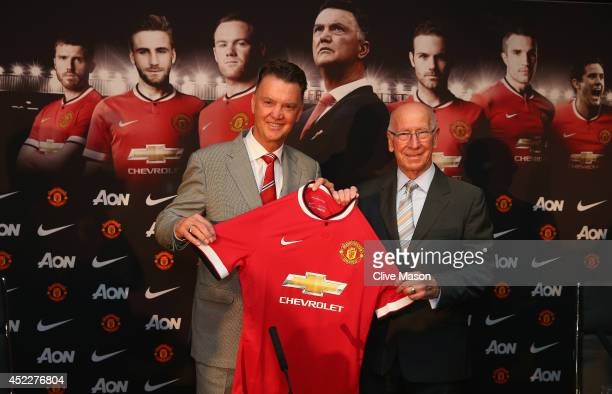Louis van Gaal appears at a press conference with Sir Bobby Charlton as he is unveiled as the new Manchester United manager at Old Trafford on July...