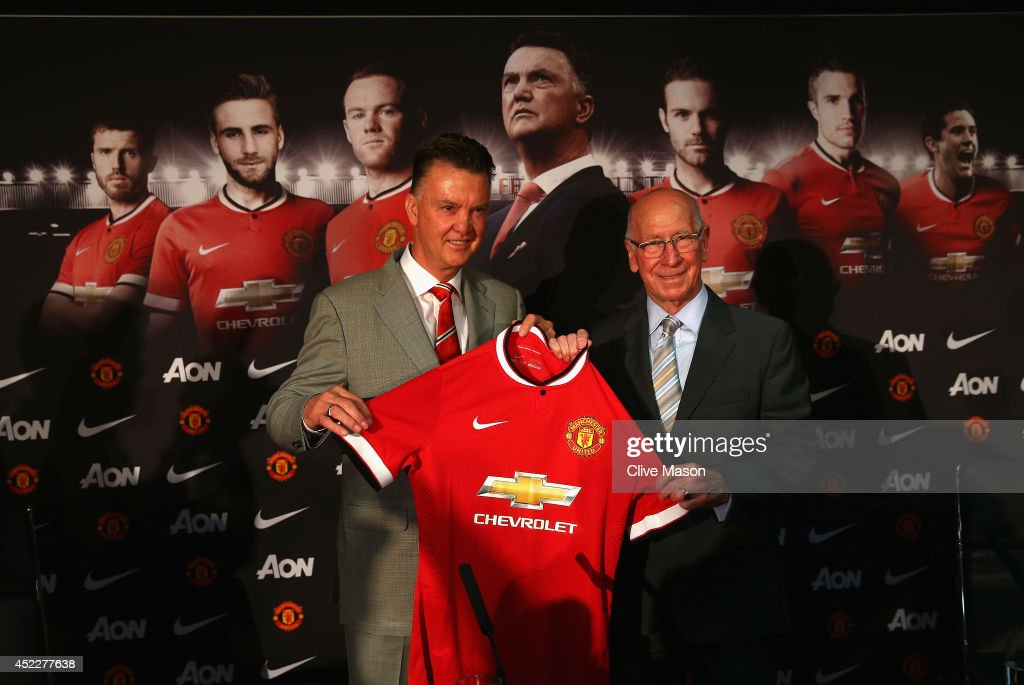 Louis van Gaal appears at a press conference with Sir Bobby Charlton as he is unveiled as the new Manchester United manager at Old Trafford on July 17, 2014 in Manchester, England.