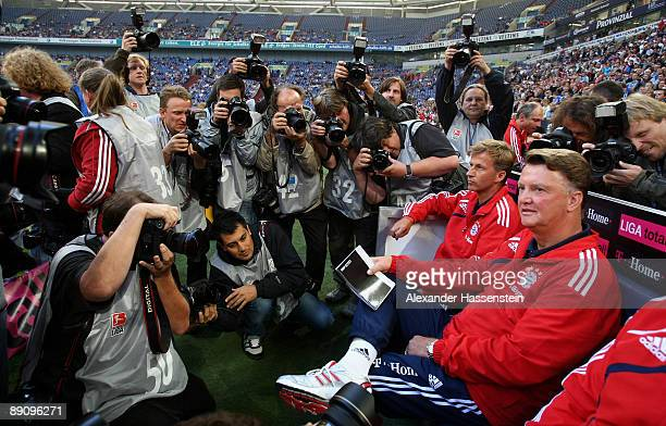 Louis van Gaal , head coach of Bayern Muenchen and his assistent coach Andries Jonker looking on prior to the second semi final match between FC...